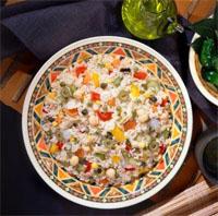 Zoutarm hoofdgerecht: Rijstsalade. Kook de rijst in water met dieetzout gaar volgens de gebruiksaanwijzing op de verpakking. Maak de paprika schoon en snijd hem in kleine blokjes.
